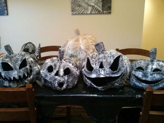 These are some paper mache pumpkins i made following a tutorial on stolloween.com. The man is an absolute paper mache genius.