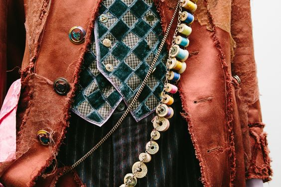 THE MAD HATTER from Disney's Alive in Wonderland: With a background in millinery, it's no surprise that the Mad Hatter has great style. Check out his sash filled with spools of thread!