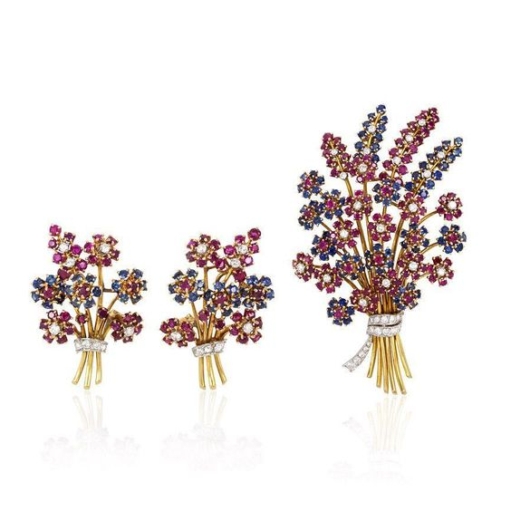 Mann's+Jewelers+A+Retro+ruby,+sapphire+and+diamond+flower+spray+brooch+with+clip+earrings+en+suite,+in+14k+gold+and+platinum.++Attributed+to+John+Rubel.