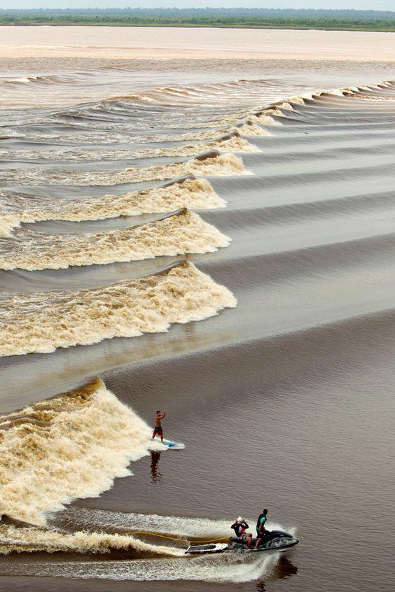 surfing the bono - the tidal river bore in malaysia