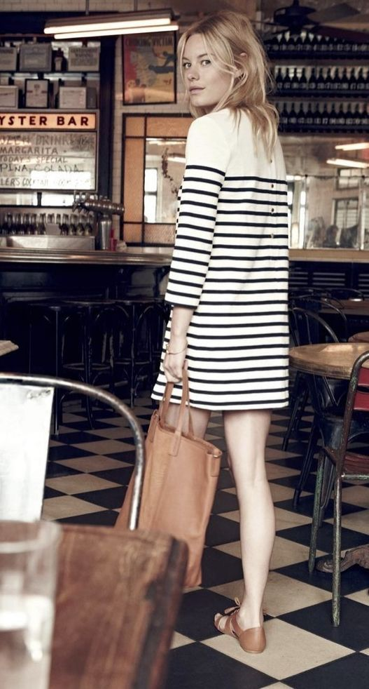 A striped dress and leather tote.:
