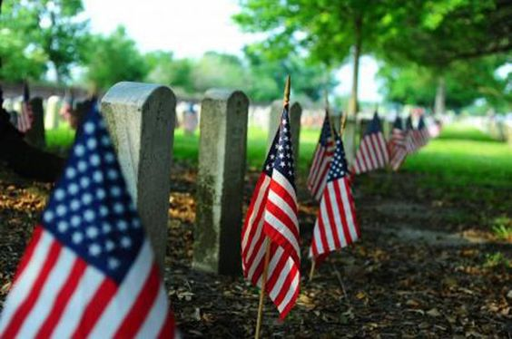 Flags decorate gravestones as a remembrance of veterans of the U.S. military at the Chalmette National Cemetery on Memorial Day, 2012.