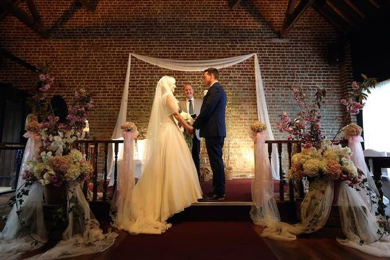 The dais in the Fathom Barn.  Decorations by Danny Watchorn Designer Florist.