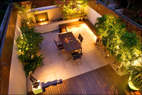 love this - lighting really brings it out! Mixture of wooden decking and outdoor tiles