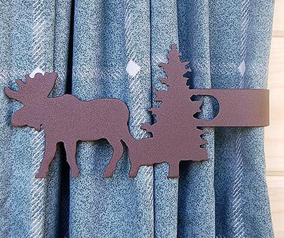 A quick and easy way to hold back your curtains is with our moose and tree curtain tie backs.