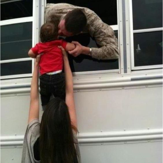 Marine saying goodbye to his baby boy before he gets sent to Afghanistan.