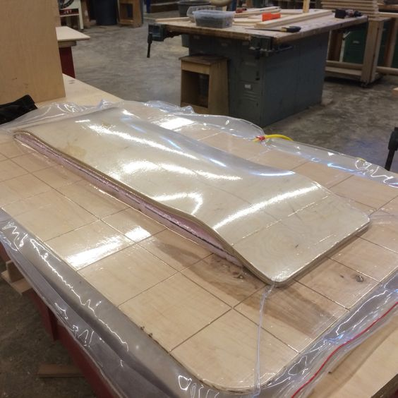 Vacuum press forming a custom skateboard.