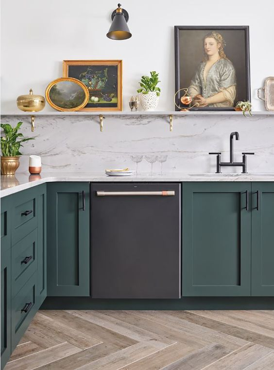 Striking black finishes have been creeping into kitchens on barstools, windows, and sinks, but now you can incorporate the bold hue into your entire kitchen suite. #kitchendecor #bhg