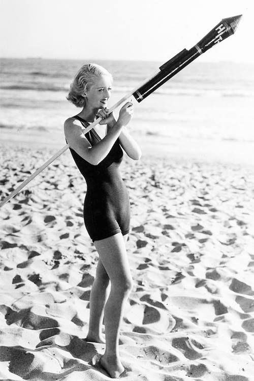 A young Bette Davis, launching a rocket for the 4th of July.: