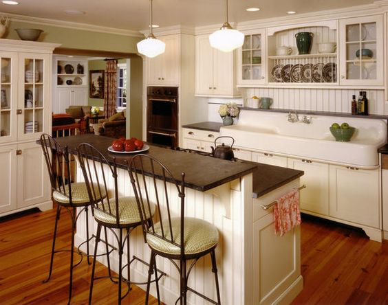 Add an Island - Kitchen Updates for Any Budget on HGTV. Like the white cabinet/bookshelf. Idea for Napa kitchen.