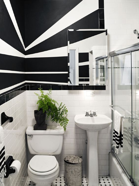 An intriguing Brooklyn Brownstone Apartment  The black and white wall designs add depth and interest. An intriguing Brooklyn Brownstone Apartment   Brooklyn brownstone