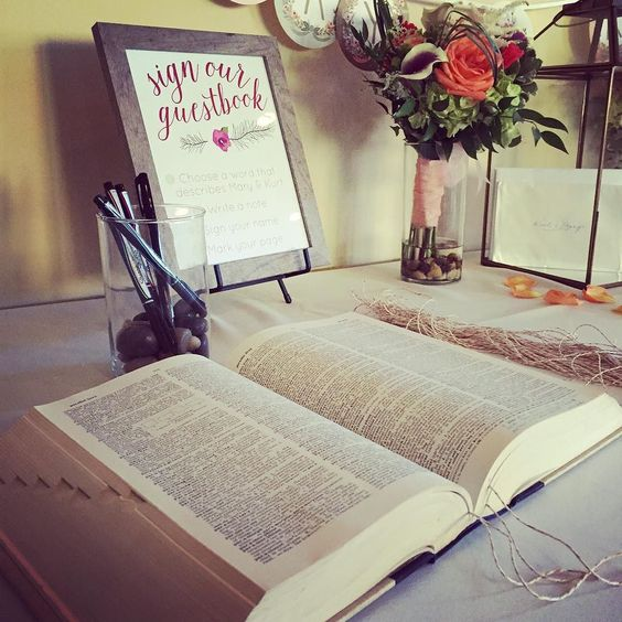 I love this guest book idea! It's a dictionary and you pick a word that describes them and sign by that! So cute! #guestbookidea #guestbook #weddingguestbook #weddingphotographer #weddingidea #wedding