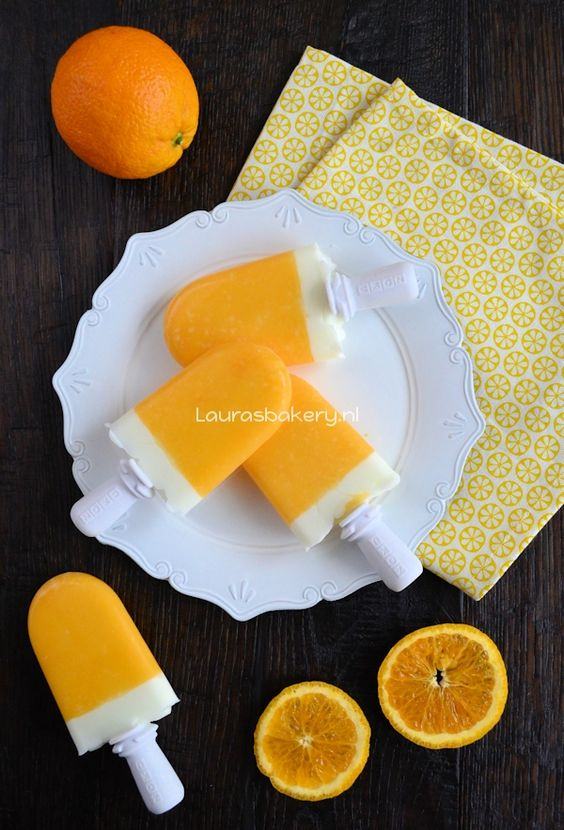 healthy popsicles, orange juice popsicles filled with yogurt.