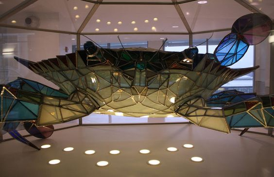 Located at Baltimore Washington International Airport (BWI) is Callinectes Douglassi, a 500-pound Chesapeake blue crab made from stained glass by artist Jackie Leatherbury Douglass and her husband John in 1984.