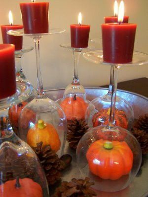 Great idea for Thanksgiving table.  Wine glasses & mini pumpkins..