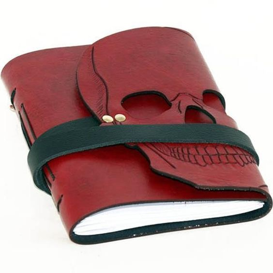 Skrocki hand carved leather skull journal liked on