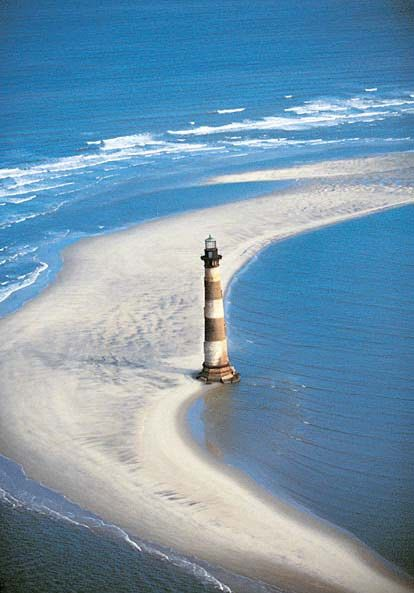 "Folly Beach lighthouse....This eccentric and diverse beach town--likes to call itself ""the edge of America."""