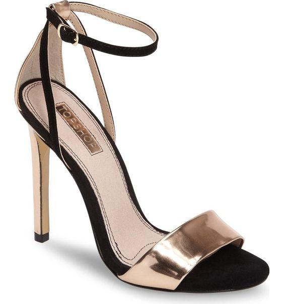Swooning over these black and gold sandals with ultra-slender ankle straps.