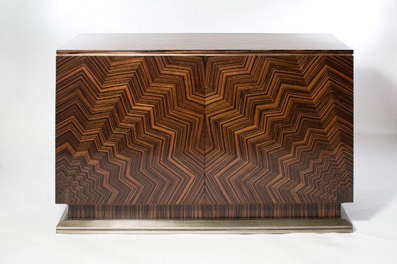 Macassar Ebony two door cabinet with Sunburst veneering and bronze finish metal leaf details.