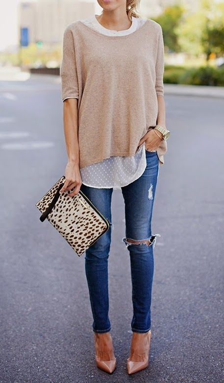 Your Daily Style Inspiration I love this look. The contrast between the torn jeans and the classy silk blouse… layered with a sweatshirt like sweater over it. And then those pinkish pumps! Just love this. So casual and yet classy for a night out.  Click to get this look.