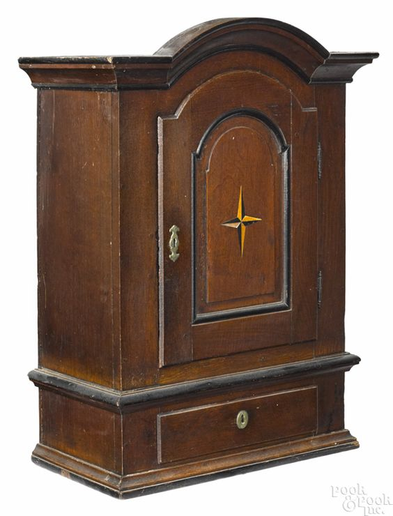 """Continental oak hanging cupboard, ca. 1760, with a star inlaid door, 37"""" H. x 23"""" W."""