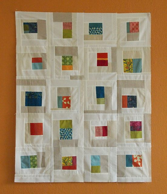 Improv Style Quilt With Lots Of White Color