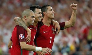 Pepe, Jose Fonte and Cristiano Ronaldo celebrate after winning the penalty shootout.
