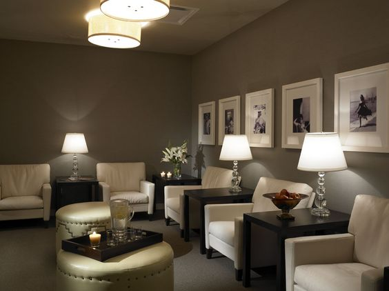 White frames on dark wall is nice also the wide mat is very nice waiting room ideas for Room spa bad