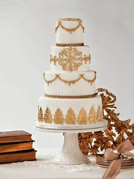 Gold decorated cake  Found at http://getmarriedcakes.com/