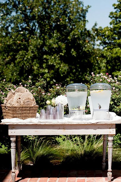 Perfect for Summer Wedding --water & fans set up by ceremony site