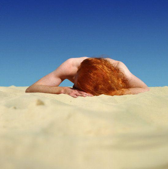 photo byAnne Zahalka: (Australia). The  Sunbather1989 from the seriesBondi: Playground of the PacificNumber: 2
