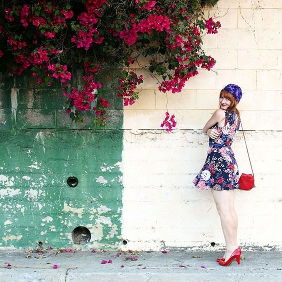 """Give winter the cold shoulder with bright florals. ✌️ (: @paintthegownred)"""