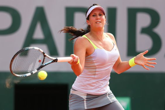 Sofia Arvidsson of Sweden plays a forehand in her Women's Singles match against Sabine Lisicki of Germany during day one of the French Open at Roland Garros on May 26, 2013 in Paris, France.