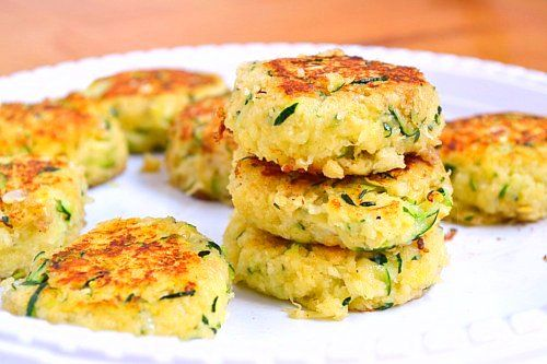 Zucchini Cakes by justputzingaround: Tender, flavorful and relatively healthy! #ZucchiniCakes #justputzingaround