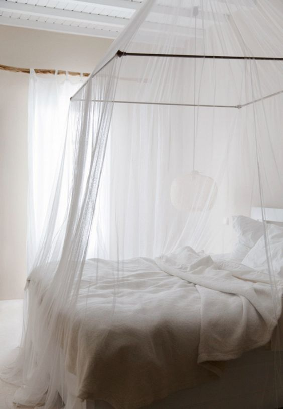 I'm currently having a thing for canopy beds. With its simple sheer paneling, this one is cozy and chic