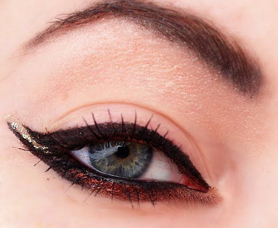A double cat eye, with gold and copper accents.