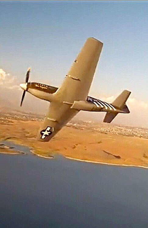"North American P-51A Mustang ""Miss Virginia"" banks away."