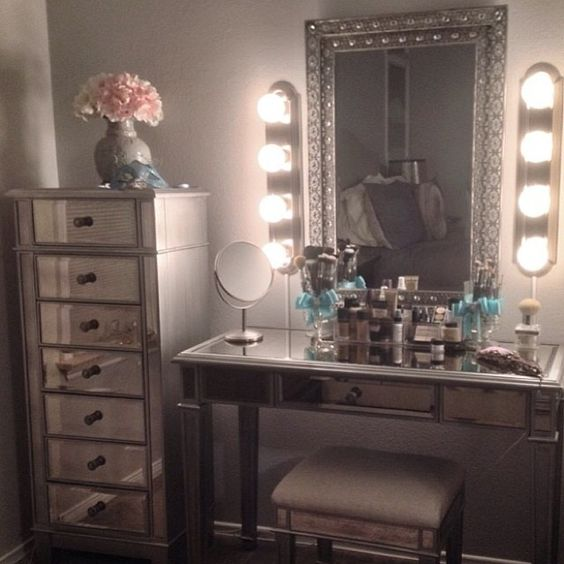 Exactly what I want mirror/lighting/mirrored storage dresser next to. Only a pretty stool. And organizer IKEA tubs. And airy wall colors lightest blush pink or wall papered
