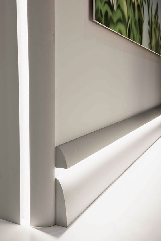 Calabasas moldings with LED lighting shown installed as a baseboard treatment; creative baseboard lighting ideas; modern molding inspiration: