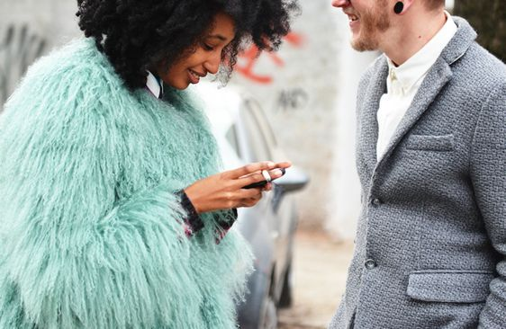 love the coloured fur, love the grey sport coat, love the little knuckle ring.