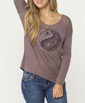 Polish a casual ensemble with this lovely top. A relaxed silhouette and scoop neck keep it perfectly laid-back, while a gorgeous graphic adds a pop of style.