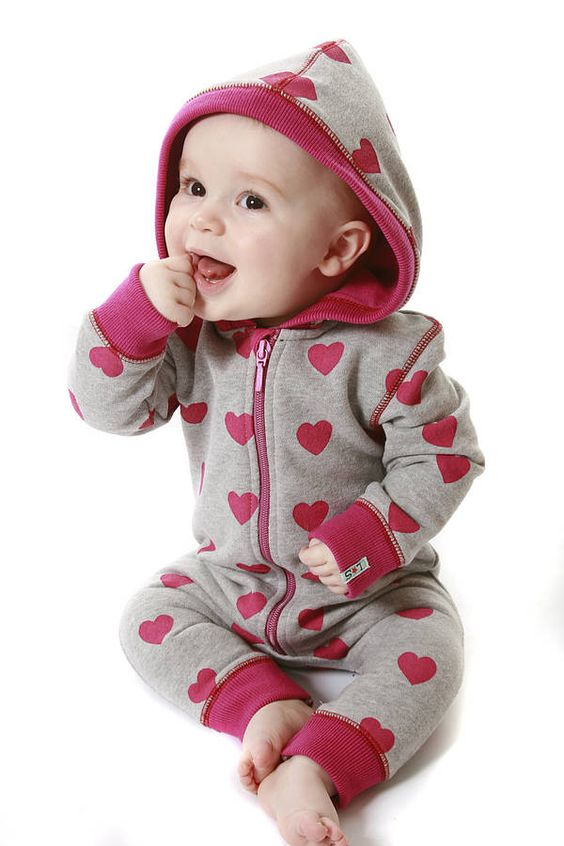 Girls All in One Sweat Hoodie.    This started life as a simple hoodie - then we added the legs! Made in our own design heart print sweatshirt fabric, this hoodie makes the ideal winter warmer for your baby girl.