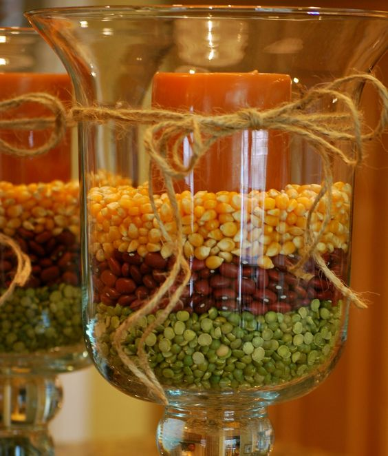 Hurricane glasses filled with dry split peas, red beans and corn kernels never looked so good! We love the twine bows as well!