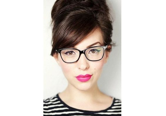 For a bolder look, sweep your hair up off your face, go for a bright pink, matte pout, and make your eyes pop with some dramaticwinged eyeliner. via StyleList