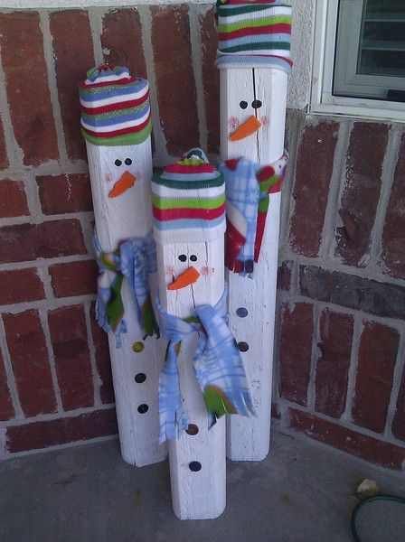 We cut the log into 3 parts, used socks from the dollar store for the hats, cut the nose chips out of wood and material of choice for scarves. Buttons hot glued down the front and paint for eyes and cheeks. :) Merry Christmas Kfeinga