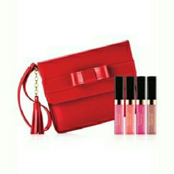 Elizabeth Arden Lip Gloss Travel Case Set Keep glam on the go with this cute travel can filled with four shades of brand new, unopened lipgloss.  Set includes .13 oz. Iridescent Mauve, Sweet Pink, Coral Kiss, and Passion Fruit.  A soft tip paddle applicator deposits the perfect amount of gloss and includes built-in mirror.  Red travel case included! Elizabeth Arden Makeup Lip Balm & Gloss