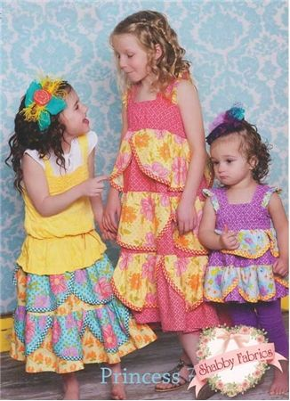 Princess+Regan:+This+pattern+contains+instructions+to+make+three+darling+pieces+for+your+little+girl!++Dress,+Top,+and+Skirt+each+feature+tiers+of+ruffles.++Child+sizes+12+months+-+10.