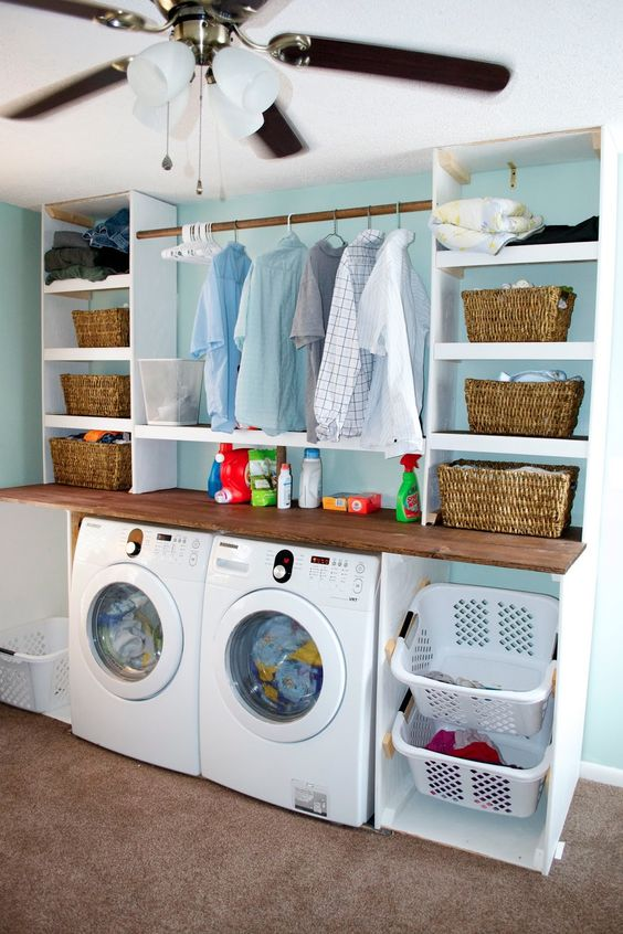 Laundry room organization. Like the angled support for laundry baskets.