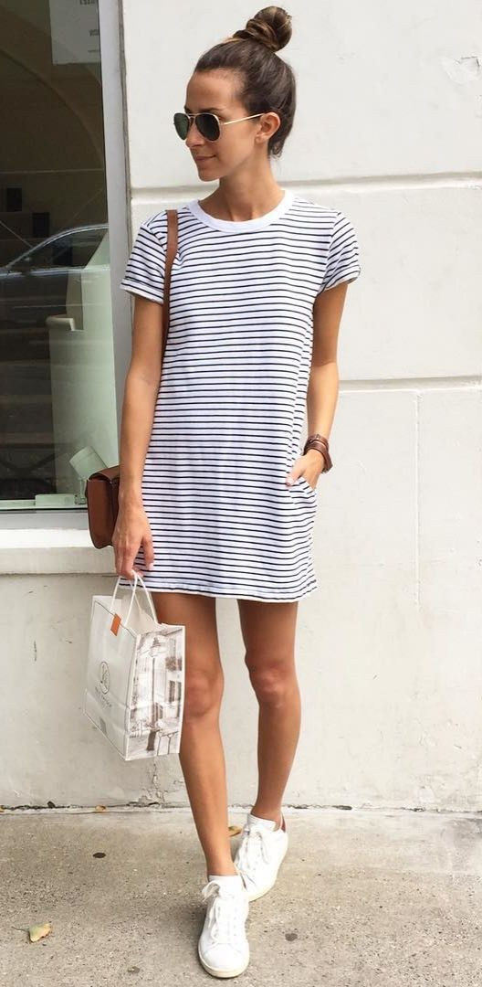 A striped t-shirt dress, white sneakers, and aviators.: