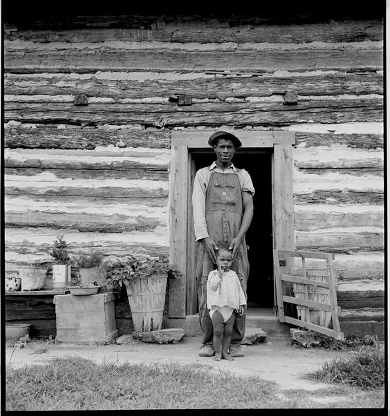 Young sharecropper and his first child. Hillside Farm. Person County, North Carolina. 1939 Dorothea Lange